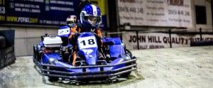 kid racing karts on bridge